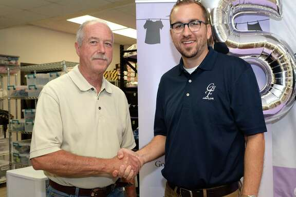 Katy Mayor Bill Hastings congratulates Executive Director Titus Benton during a celebration of the 50,000th client served by Clothed By Faith in Katy on Friday, Aug. 16.