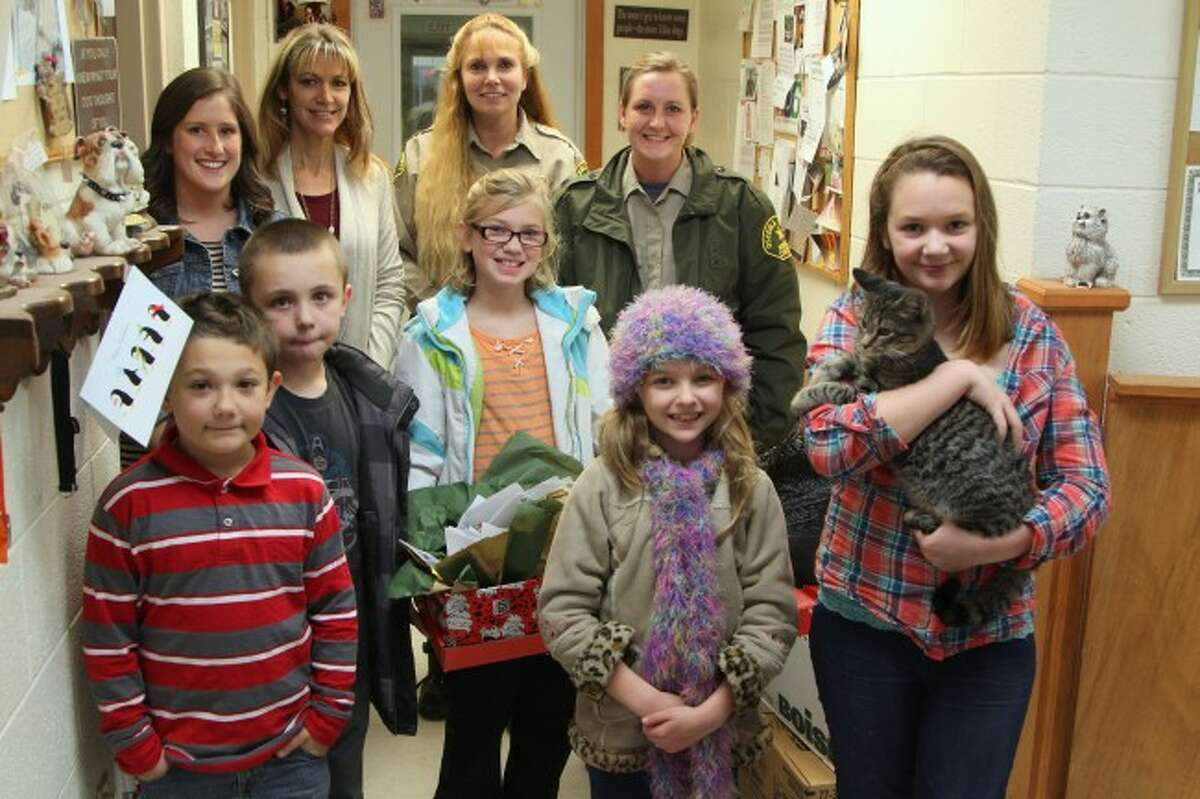 WAGS AND WHISKERS: Student donations included dog and cat food, toys, treats, blankets, and cleaning supplies such as bleach and towels. In return, animal control director Michelle Kuz gave the students a thank-you gift for their generosity. She said the supplies will help the shelter for a few weeks.