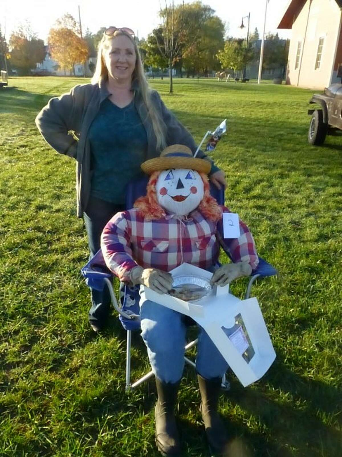 Penny Nichols-Whitehead took home the winning prize for her scarecrow during the Evart Farmers Market scarecrow contest that took place on Saturday, Oct. 12. (Courtesy photo)