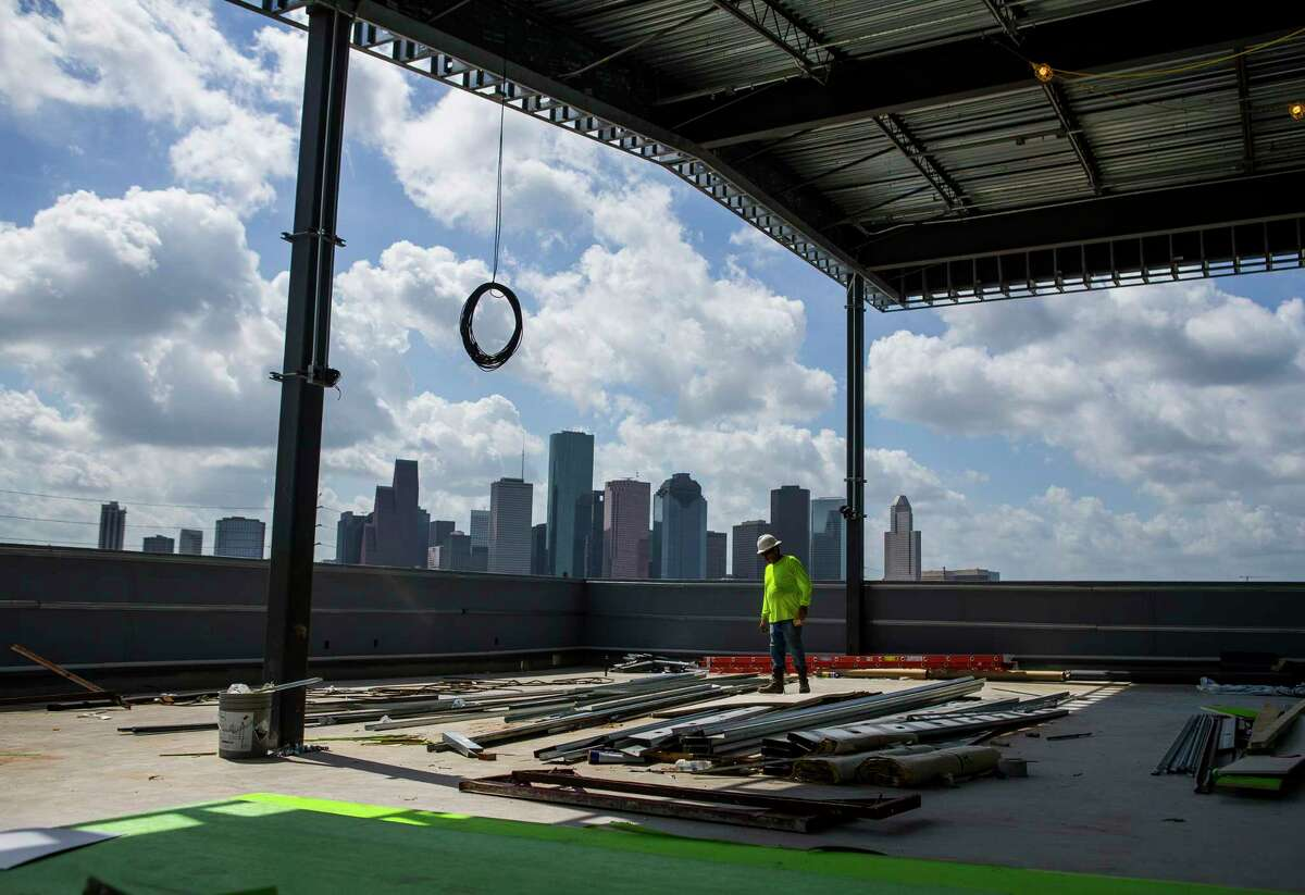Construction continues on a shaded third floor space for visitors at the future new home of Buffalo Bayou Brewing Co. on Summer Street in Houston, Thursday, Aug. 8, 2019.