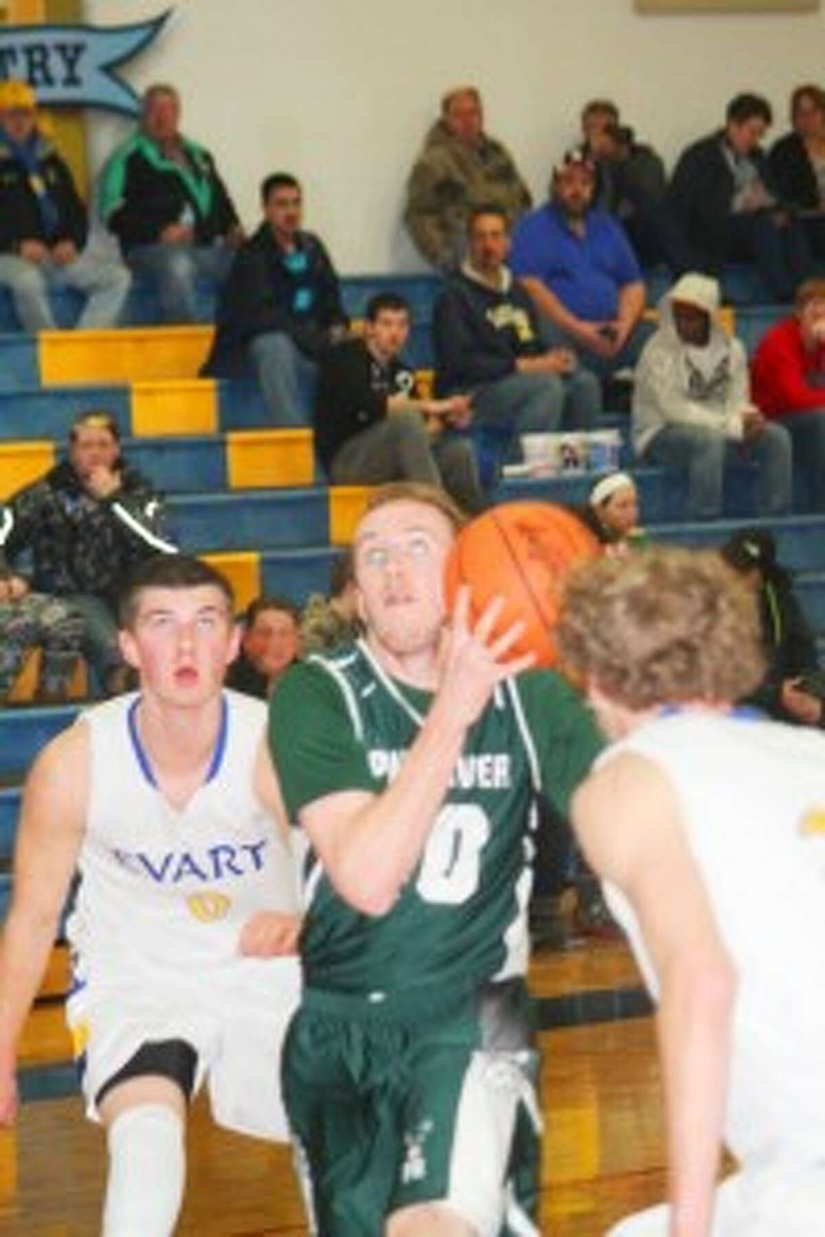 Season: Pine River's Lucas Harris attacks the basket against Evart. (Herald Review photo/John Raffel)