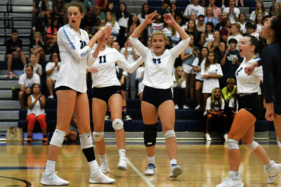 Kingwood's Jordan Rambo (23), leads the celebration with her teammates Megan Wilson (30, Hannah Smith (11), Rachel Easom (2), and Lizzy Young, right, after winning a point against Kingwood Park in their non-district matchup at Kingwood High School on Aug. 16, 2019. Photo: Jerry Baker,  Houston Chronicle / Contributor / Houston Chronicle