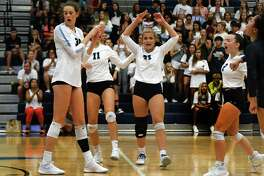 Kingwood's Jordan Rambo (23), leads the celebration with her teammates Megan Wilson (30, Hannah Smith (11), Rachel Easom (2), and Lizzy Young, right, after winning a point against Kingwood Park in their non-district matchup at Kingwood High School on Aug. 16, 2019.