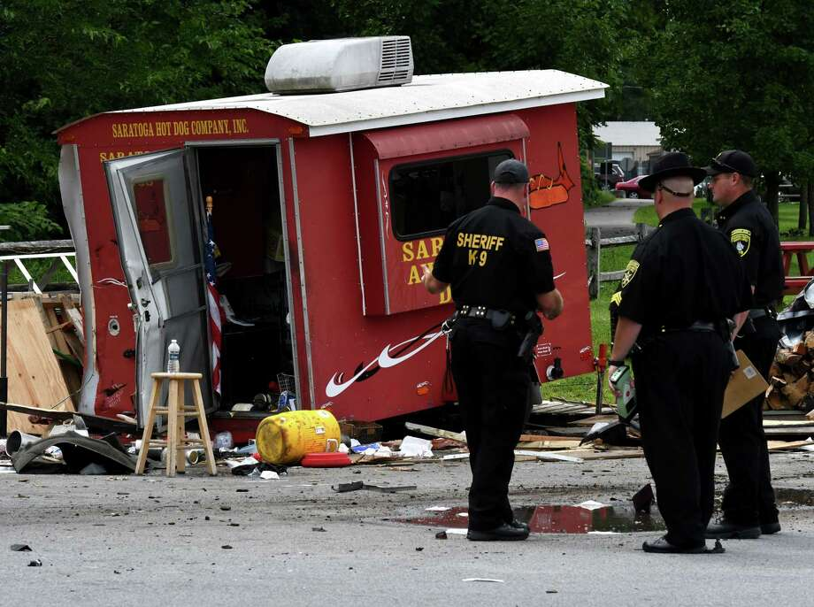 Police investigate the scene of a motor vehicle crash where the driver of an SUV lost control of his vehicle at the intersection of Marion and Excelsior avenues, injuring five people after hitting a hot dog stand and three cars on Monday, Aug. 19, 2019, Saratoga Springs, N.Y. The driver, whom police did not immediately identify, and all five people struck were taken to Saratoga Springs Hospital for evaluation. None of their injuries were considered life-threatening. (Will Waldron/Times Union) Photo: Will Waldron, Albany Times Union