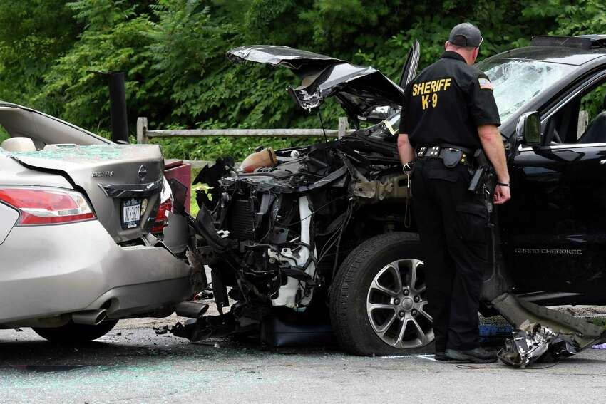 Police investigate the scene of a motor vehicle crash where the driver of an SUV lost control of his vehicle at the intersection of Marion and Excelsior avenues, injuring five people after hitting a hot dog stand and three cars on Monday, Aug. 19, 2019, Saratoga Springs, N.Y. The driver, whom police did not immediately identify, and all five people struck were taken to Saratoga Springs Hospital for evaluation. None of their injuries were considered life-threatening. (Will Waldron/Times Union)