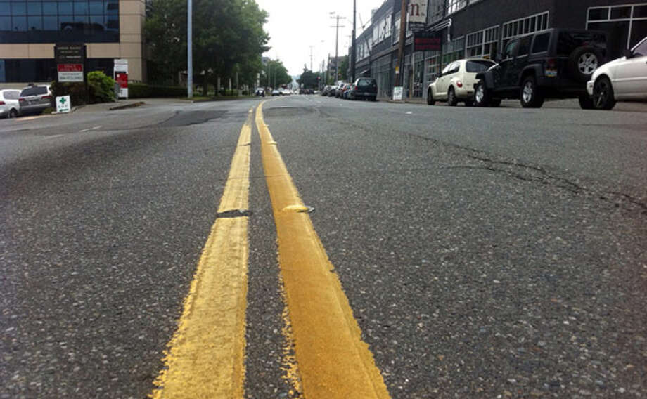 Overnight Monday, Aug. 19 2019, the city of Troy will re-stripe two-lane city roads with double yellow lines. Photo: Casey McNerthney/seattlepi.com File