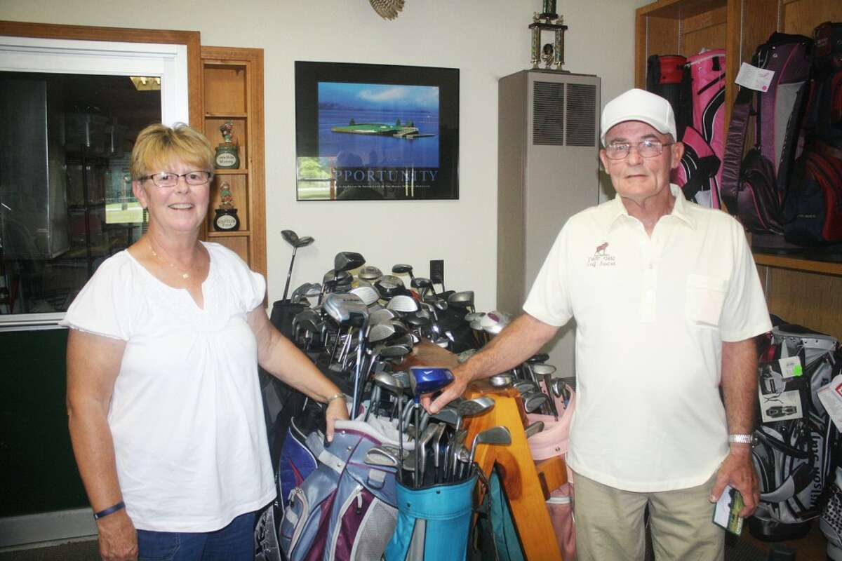 LEADERS: Barb Szymanski, left and Lee Perleberg have formed one of the top teams in the Evart Moose League at the Birch Valley Golf Course. (Pioneer photos/John Raffel)