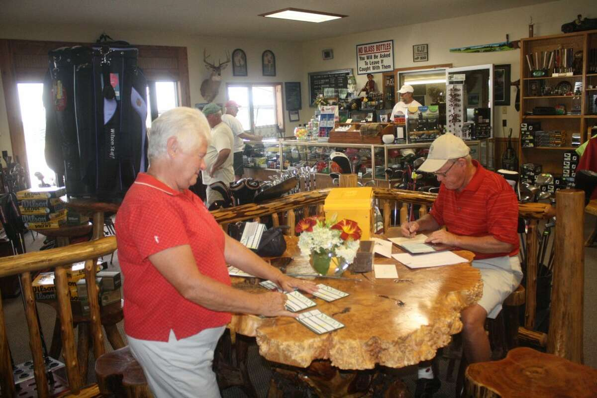 READY TO GO: Kent and Nancy Lang have been coordinating the Tuesday Moose League at Birch Valley Golf Course.