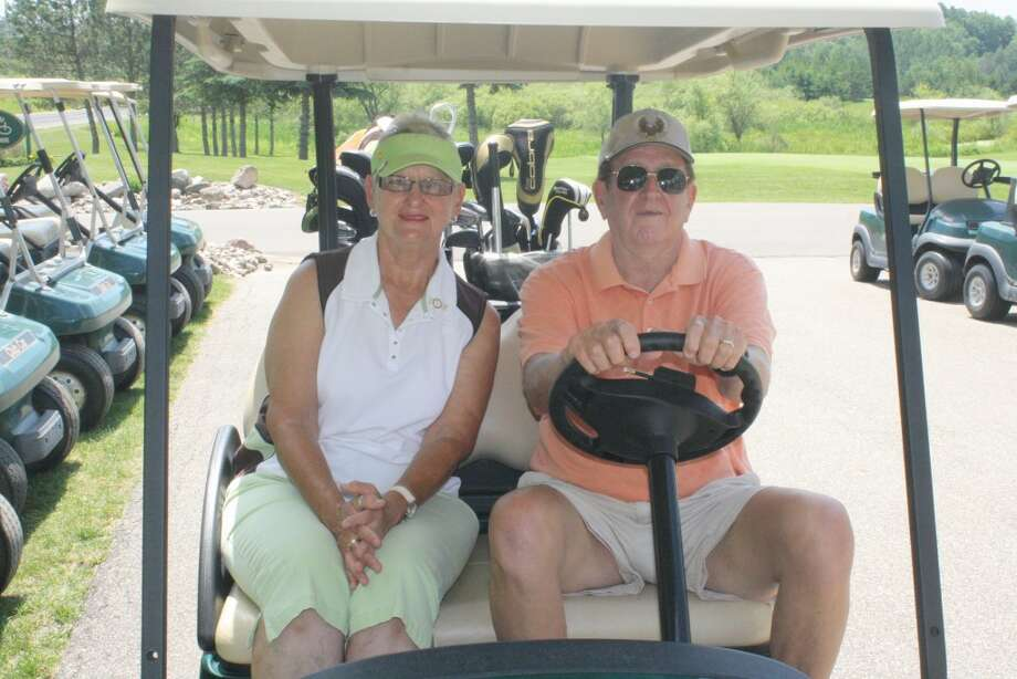 GOOD TIME: Janice Ross and her neighbor and golf partner Tom VanEpps get ready for another round of golf at Tustin Trails Golf Course. (Herald Review photo/John Raffel)