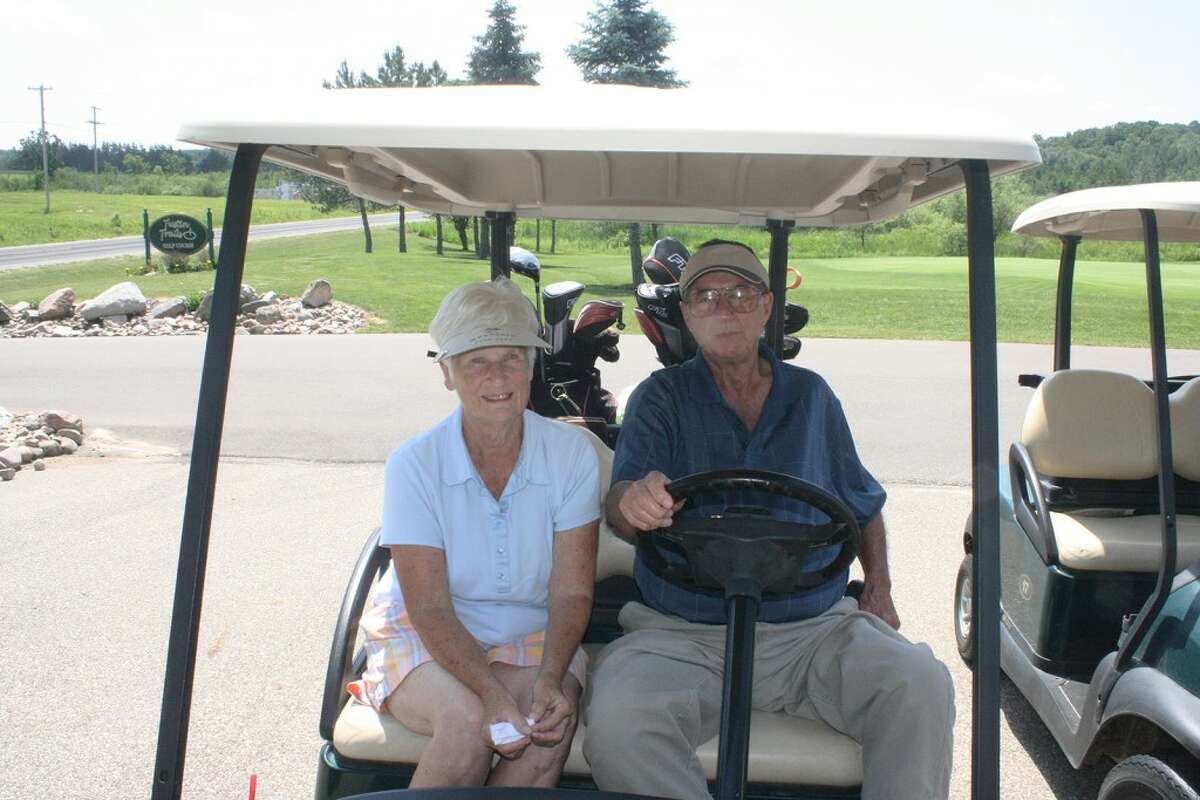 TEEING OFF: Marge and Jerry Selbee, of Evart, get ready for another day of action in the Tustin Trails Golf Course couples league. (Herald Review photo/John Raffel)