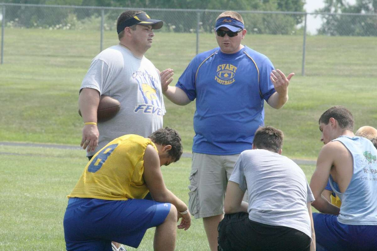 GAME PLAN: Coach Pat Craven chats with his football team after Saturday's Pine River 7-on-7 passing tournament. (Herald Review photo/John Raffel)