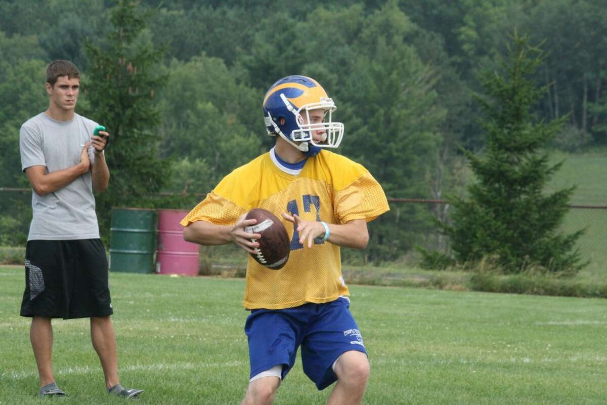 TIMING: Jacob Fortune of Evart tosses a pass during Saturday's 7-on-7 passing tournament at Pine River.