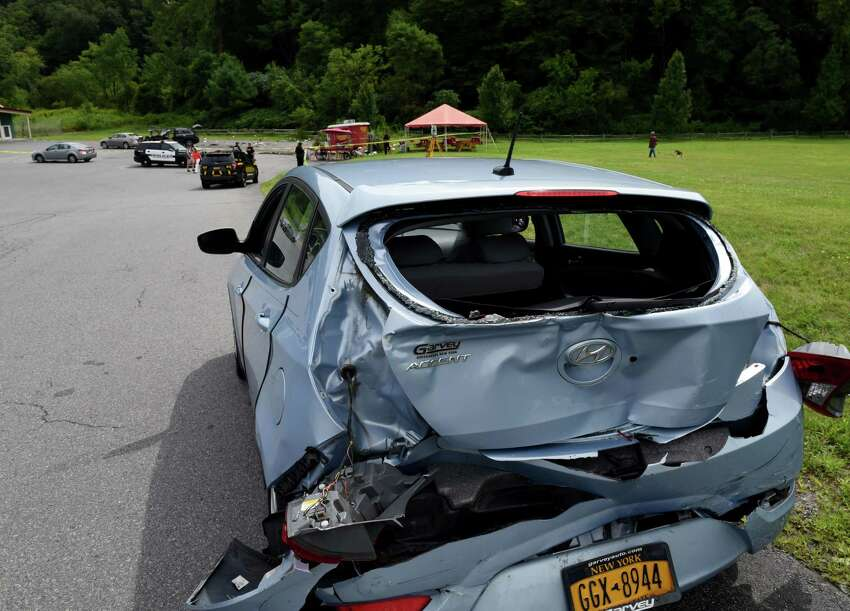 One of the cars struck after the driver of an SUV lost control of his vehicle at the intersection of Marion and Excelsior avenues, injuring five people after hitting a hot dog stand and three cars on Monday, Aug. 19, 2019, Saratoga Springs, N.Y. The driver, whom police did not immediately identify, and all five people struck were taken to Saratoga Springs Hospital for evaluation. None of their injuries were considered life-threatening. (Will Waldron/Times Union)