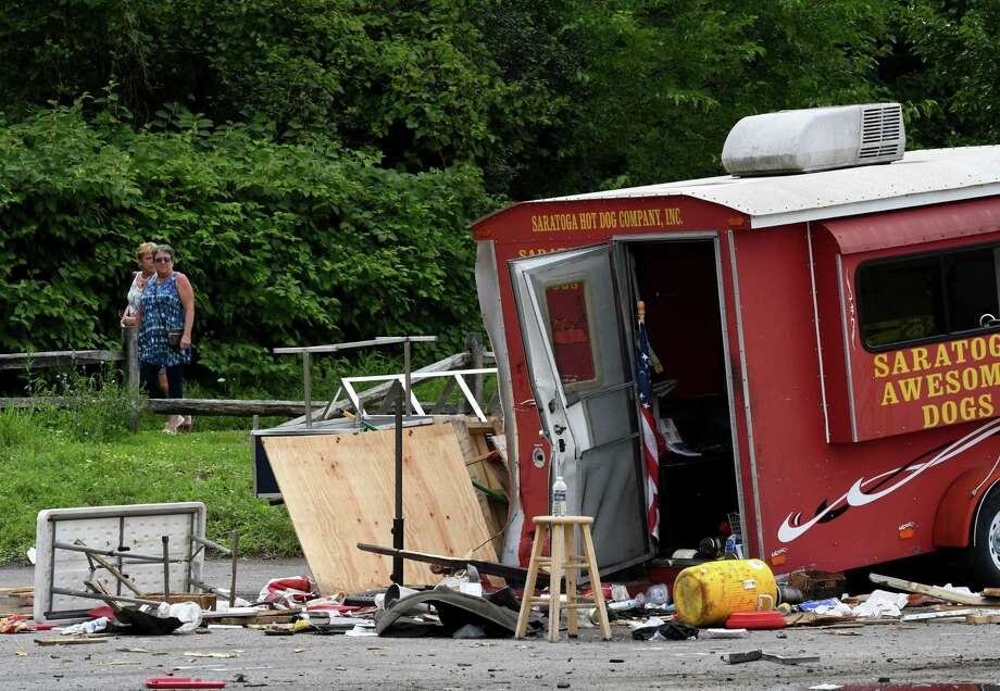 Scene of a motor vehicle crash where the driver of an SUV lost control of his vehicle at the intersection of Marion and Excelsior avenues, injuring five people after hitting a hot dog stand and three cars on Monday, Aug. 19, 2019, Saratoga Springs, N.Y. The driver, whom police did not immediately identify, and all five people struck were taken to Saratoga Springs Hospital for evaluation. None of their injuries were considered life-threatening. (Will Waldron/Times Union) Photo: Will Waldron, Albany Times Union