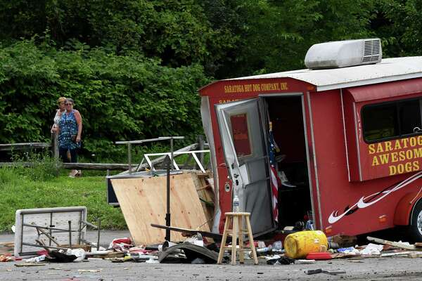 Scene of a motor vehicle crash where the driver of an SUV lost control of his vehicle at the intersection of Marion and Excelsior avenues, injuring five people after hitting a hot dog stand and three cars on Monday, Aug. 19, 2019, Saratoga Springs, N.Y. The driver, whom police did not immediately identify, and all five people struck were taken to Saratoga Springs Hospital for evaluation. None of their injuries were considered life-threatening. (Will Waldron/Times Union)