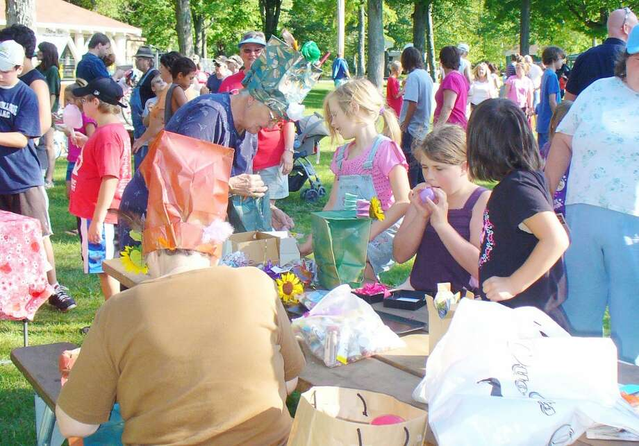 BLOCK PARTY: National Night Out is an event to make the community safer through strengthening bonds between law enforcement and the community. The sixth annual event will be held from 6 to 8 p.m. on Aug. 7 at Riverside Park in Evart. (Herald Review file photos)