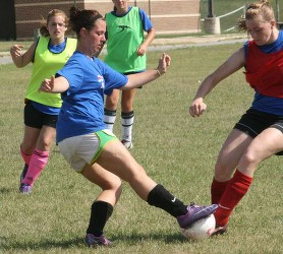 50-50 BALL: Reed City's Tia Lintemuth fights for the ball during the Coyotes' soccer camp on Monday. (Pioneer photo/John Raffel)