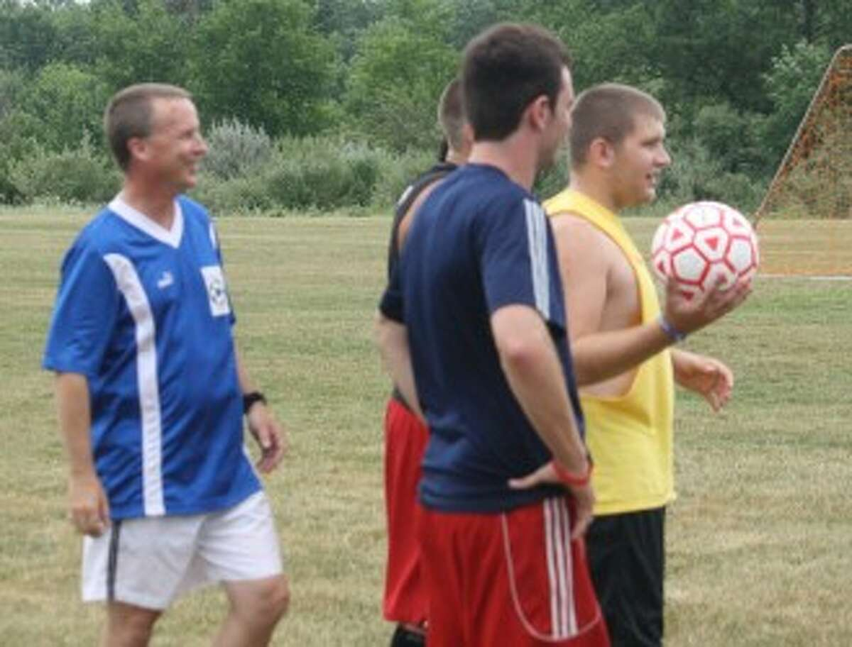 LOOKING THINGS OVER: Reed City soccer coach Dave Mix keeps an eye on the action during a practice last week. (Pioneer photo/John Raffel)