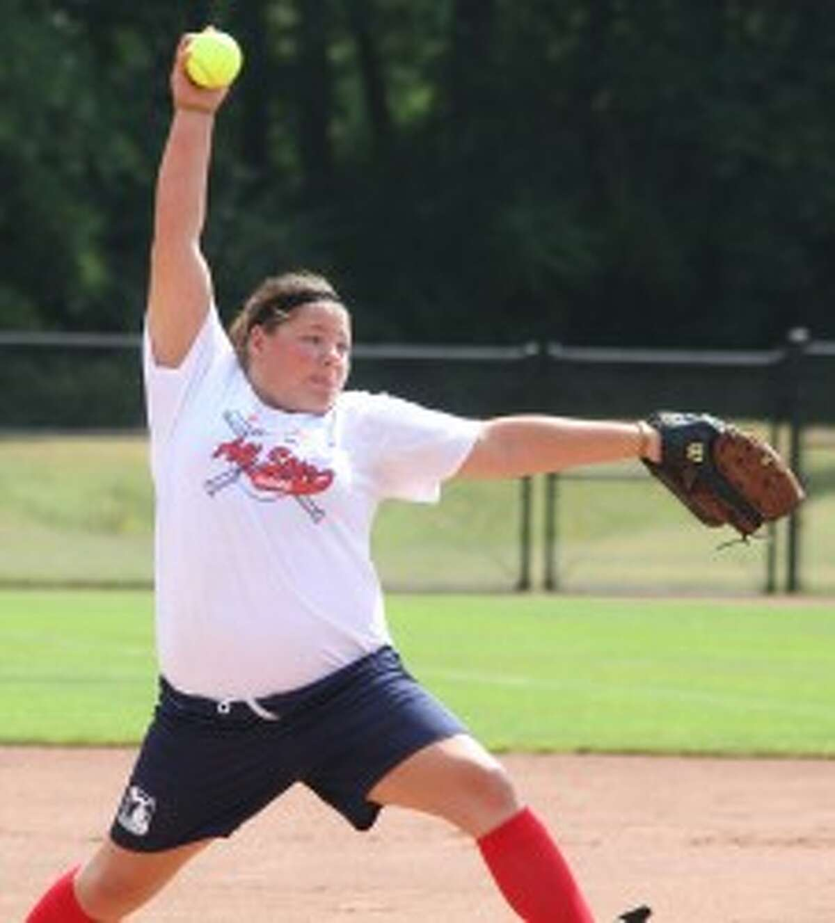 SPECIAL DELIVERY: Reed City graduate Courtney Morgan fires in a pitch.
