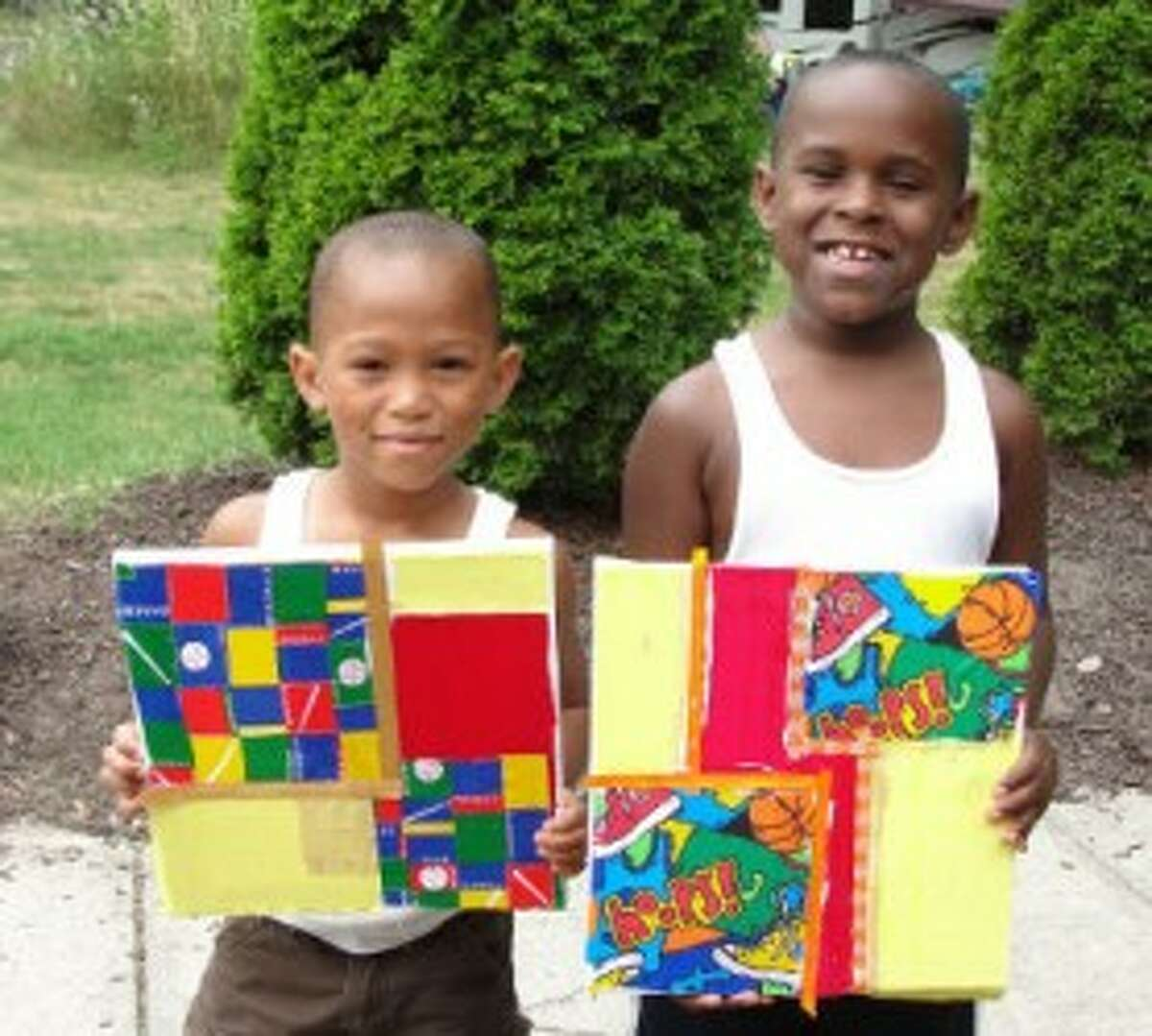NO. 1: Brothers Marcellus, 5, and Mariano, 6, proudly display their sports themed collages.