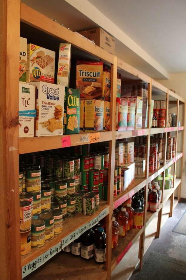 SPARCE SHELVES: The Reed City Ministerial Association Food Pantry supplied food to 3,589 individuals from January to June - 700 more individuals than the first six months of last year. (Herald Review photos/Sarah Neubecker)