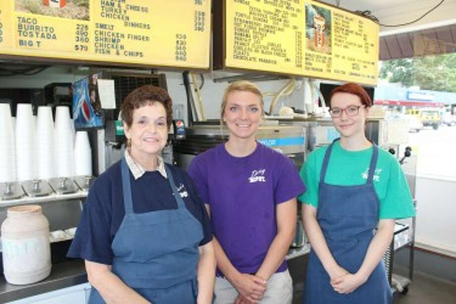 DEPOT CREW: The Dairy Depot offers a wide range of food and ice cream favorites. Pictured (from left) are employees Sandy Stump, Nicole McDonald and Mary Cooper. Stump has worked at the Depot for more than 30 years. (Herald Review photo/Sarah Neubecker)