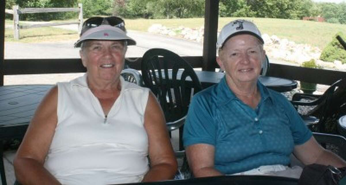 AT THE TURN: Joan Foote (left) and Susan Staton get ready for a round of golf at Spring Valley. (Pioneer photo/John Raffel)