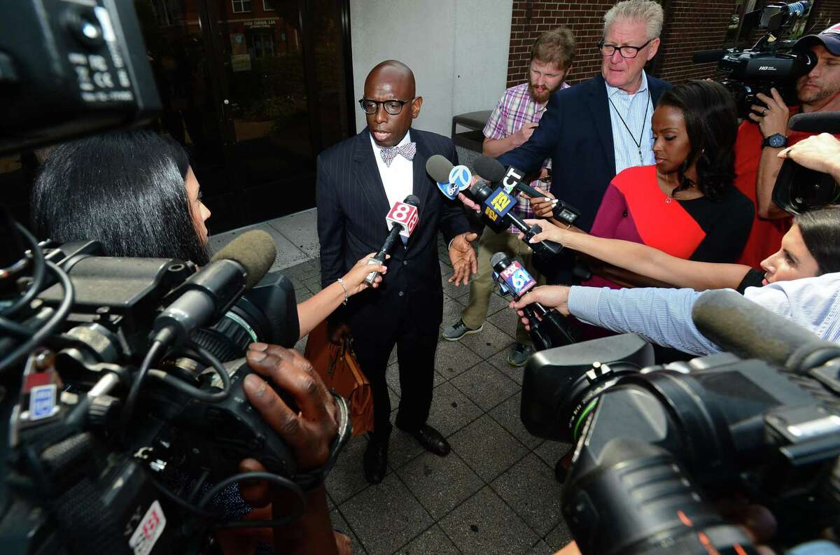Darnell Crosland, attorney for Brandon Wagshol, who is charged with four counts of illegal possession of large capacity magazines, speaks to the press following Wagshol's arraignment in state Superior Court in Norwalk on Friday.