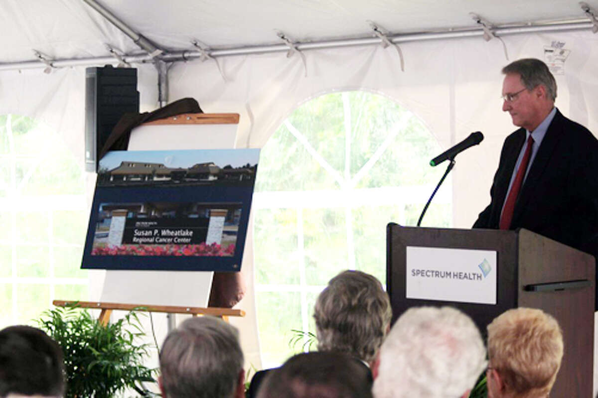 NVEILED: Sam Daugherty, Spectrum Reed City Hospital chief operating officer, unveils the name of the new Susan P. Wheatlake Regional Cancer Center. Wheatlake was first diagnosed with cancer in 2005 and has since been dedicated to cancer education and treatment for others.