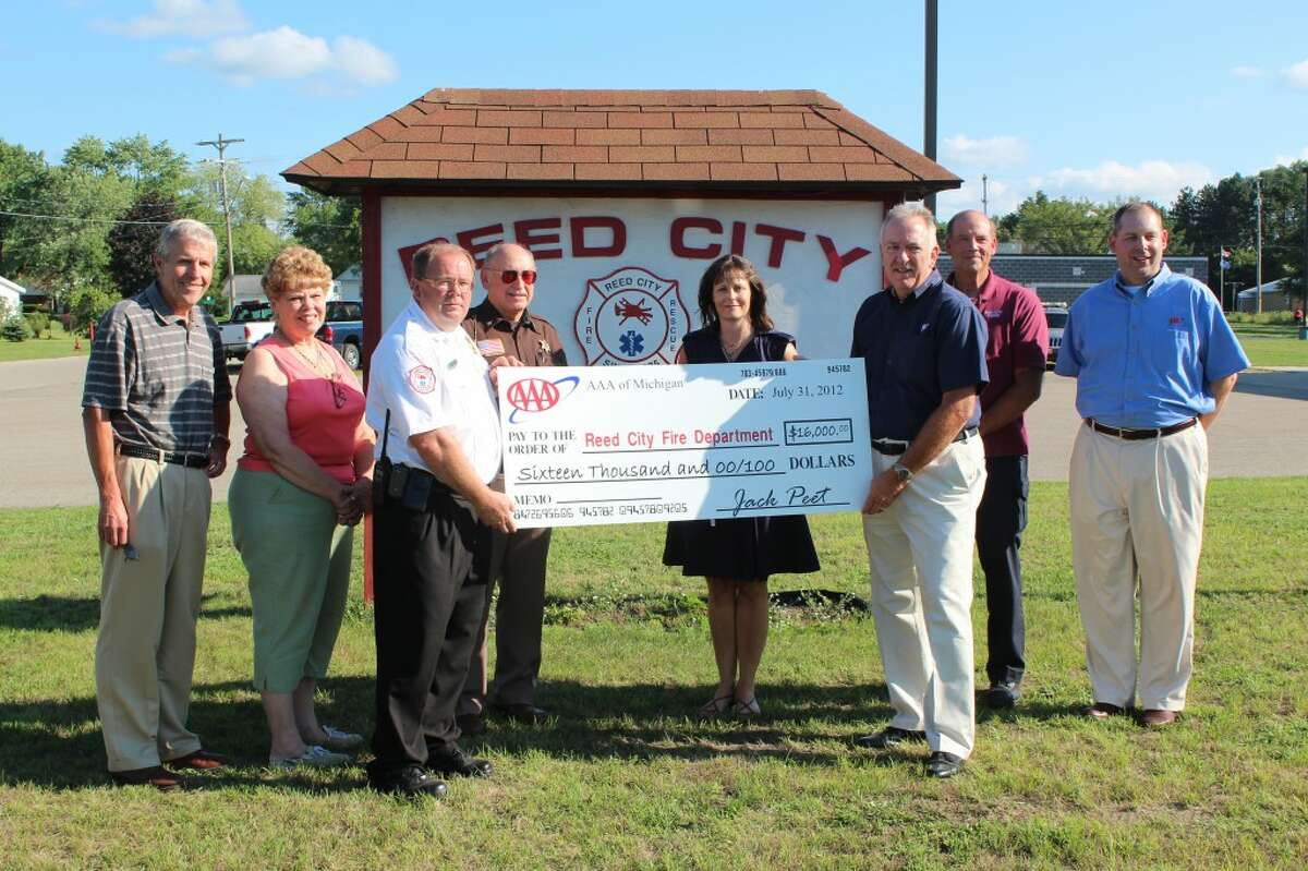 NEW EQUIPMENT: The Reed City Fire Department accepts a $16,000 grant from AAA for new rescue tools. Pictured (from left to right) is Ron Marek, Reed City city manager; Marlene Fatum, Reed City councilwoman; Dave Belden, assistant fire chief; Jim Crawford, Osceola County Sheriff; Darlene Fuller, Reed City councilwoman; Jack Peet, AAA northern region traffic safety manager; Chuck Davis, Reed City police chief and David VanderWeele, AAA field sales manager.
