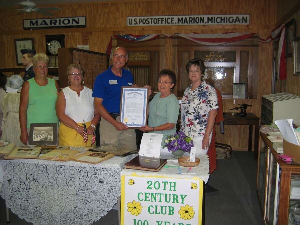 Club members celebrate 100 years of history. Left to right: Beverly Orvis Sharon Cutler, Rep. Johnson, club president Carolyn Ahrens, Sue Weisburg. (Herald Review photo/Randy Johnston)