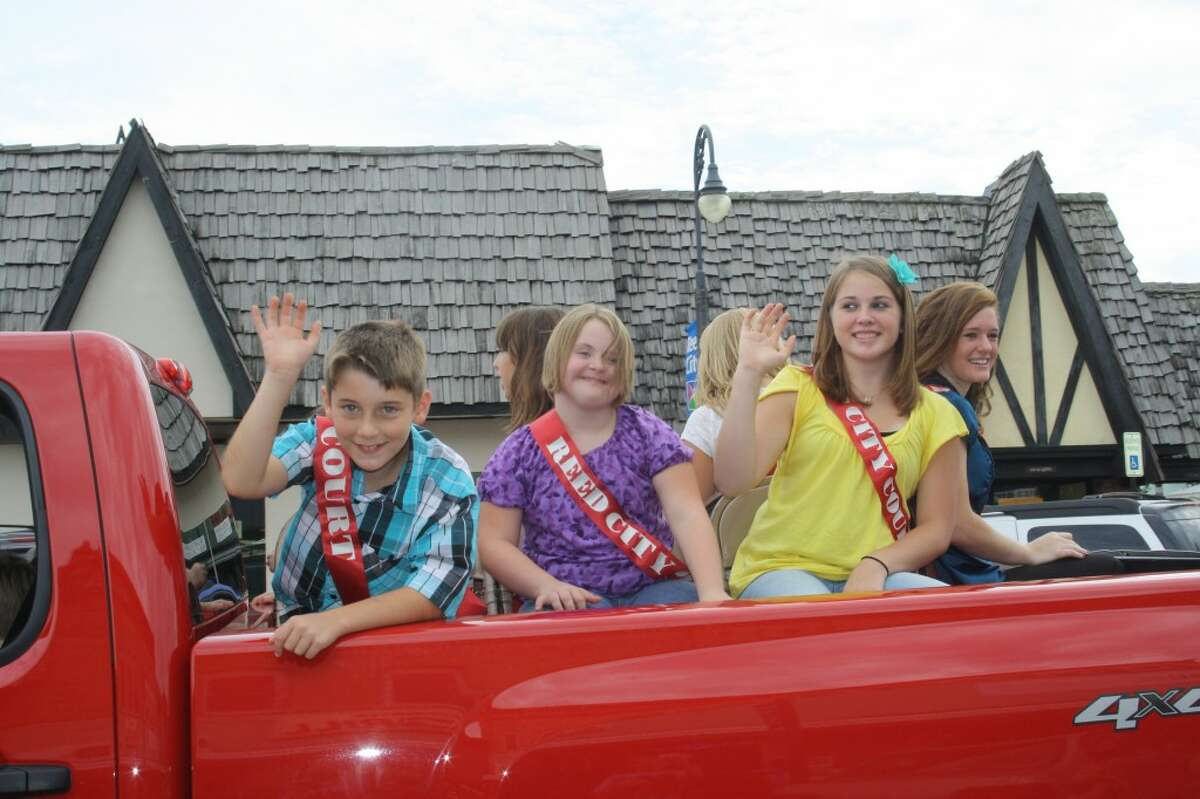 FAMILY CELEBRATION: The Great American Crossroads Celebration will be held Aug. 15 to 18, beginning with the Miss Reed City/Prince Pageant. The weekend will include softball tournaments, a fashion show and a parade, and will draw around 1,000 people to the area. (Herald Review file photos)