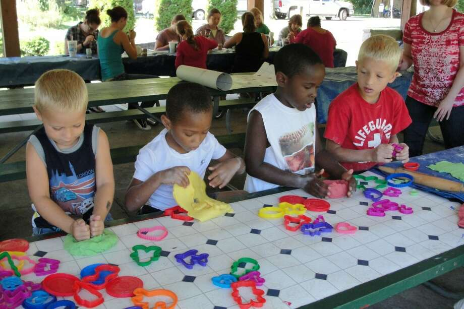 ART: Children show their art made during Art in the Park on Saturday. (Herald Review photos/Shannon Hartley)