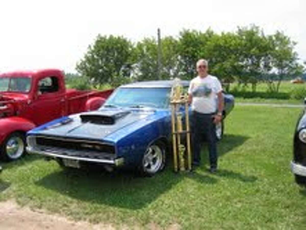 MARION DAYS: Ed Rousseau, winner of the Nancy Brackett Memorial trophy, with his '68 Dodge Charger R/T. (Herald Review photos/Randy Johnston)