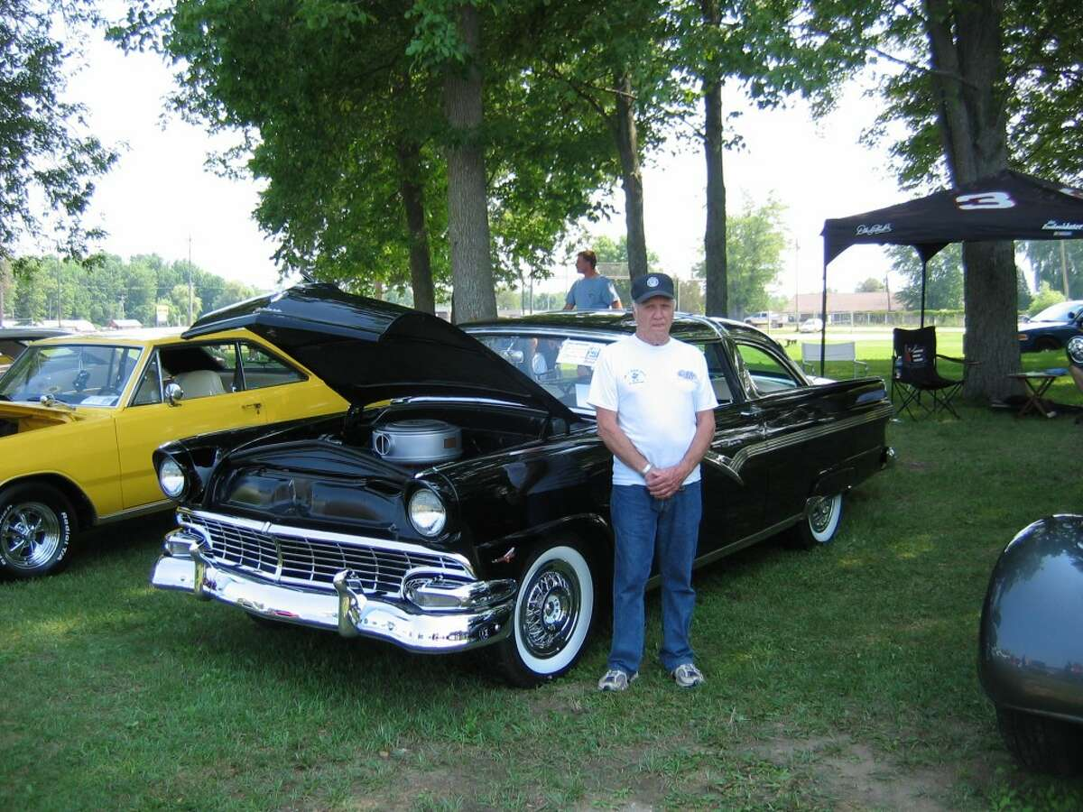 COOL CAR:Tom Leski from Elmira poses with his '56 Ford Crown Victoria.