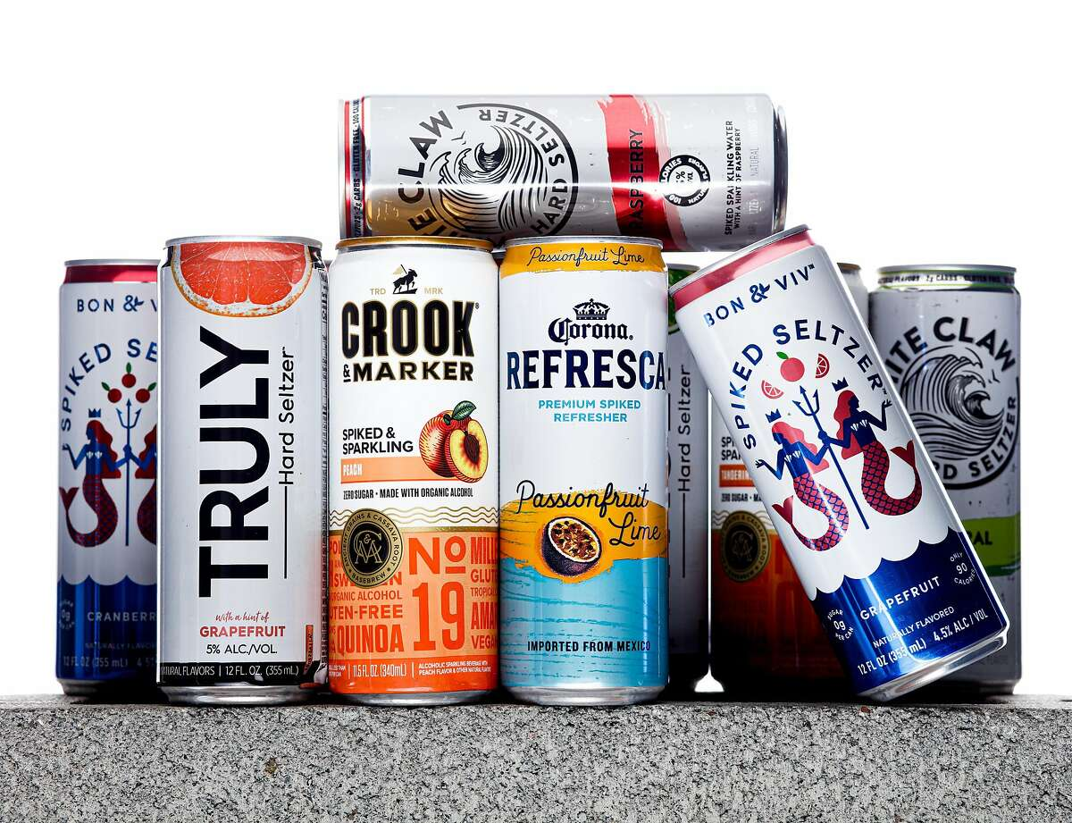 Cans of hard seltzer from Truly, Crook and Marker, Corona Refresca, Bon and Viv, and White Claw are seen on Tuesday, Aug. 13, 2019 in San Francisco, Calif. Hard seltzers were the drink trend of 2019.