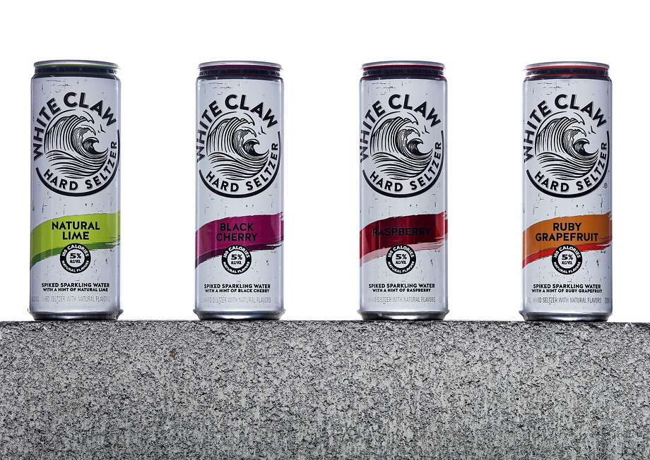 Cans of White Claw Hard Seltzer are seen on Tuesday, Aug. 13, 2019 in San Francisco, Calif. Flavors from left are Natural Lime, Black Cherry, Raspberry, and Ruby Grapefruit. Hard seltzers were the drink trend of 2019. Photo: Russell Yip, The Chronicle