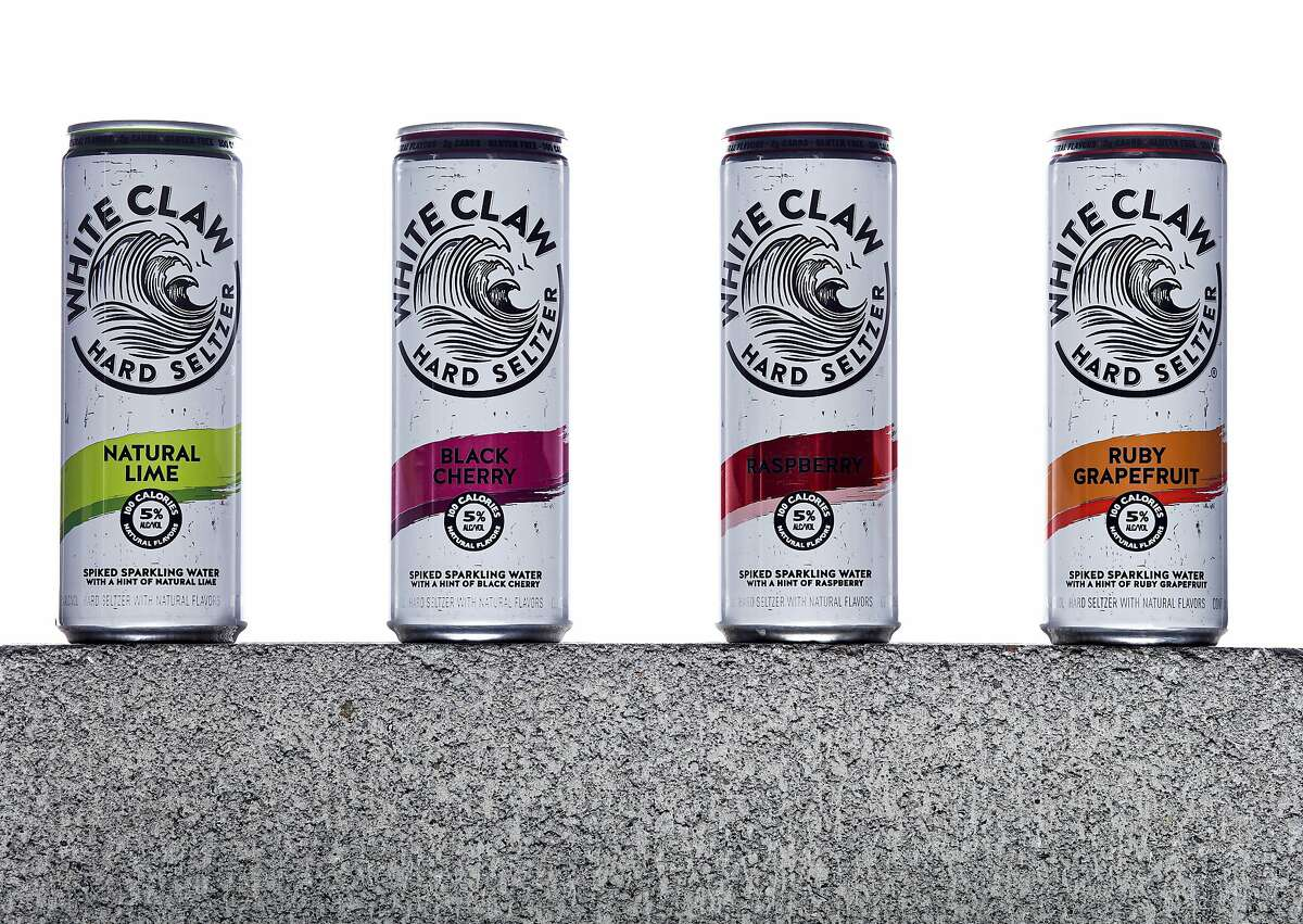 Cans of White Claw Hard Seltzer are seen on Tuesday, Aug. 13, 2019 in San Francisco, Calif. Flavors from left are Natural Lime, Black Cherry, Raspberry, and Ruby Grapefruit. Hard seltzers were the drink trend of 2019.