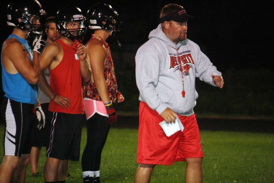 Reed City football coach Monty Price gives instructions during Sunday's midnight madness. (Pioneer photo/John Raffel)