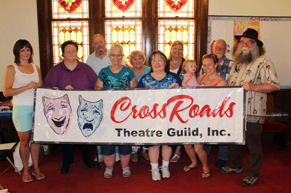 COMEBACK: The Crossroads Theatre Guild will hold auditions Aug. 23 to 25 for 18 parts and volunteers will be accepted for many behind-the-scenes roles. Pictured (from left) is Darlene Fuller, treasurer, Deb Lockwood, president, Ron Ingraham, Linda Backus, secretary, Lois Ingraham, Carolyn Geib, vice president, Shari Ingraham, Sarah Spitzley (holding Leidyn Spitzley), Roger Hicks and Timothy Locker, director. (Herald Review photo/Sarah Neubecker)
