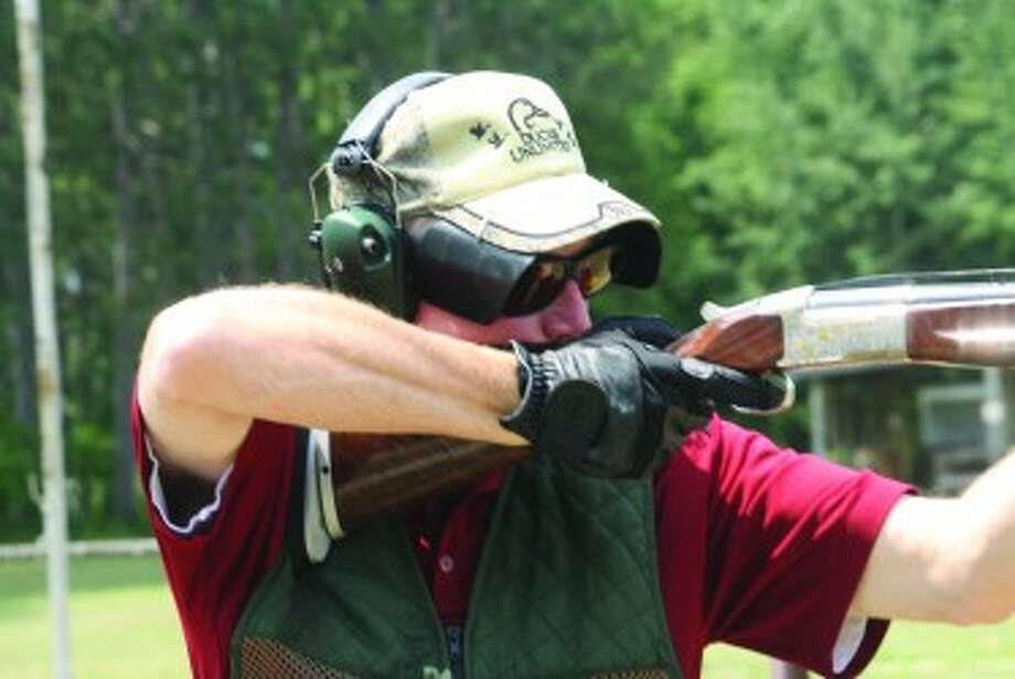 READY, AIM: Todd Dew takes aim at a target at the Reed City Sportsman Club. (Herald Review photo/John Raffel)
