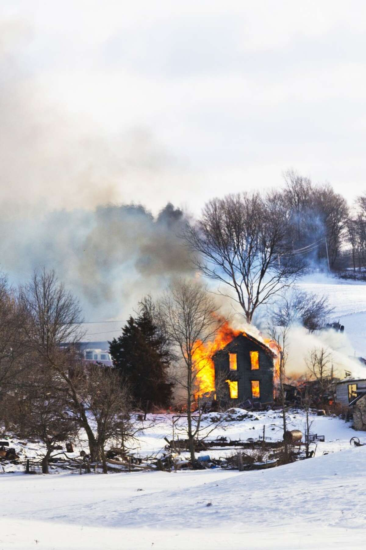 HOUSE DESTROYED: The fire began around 9 a.m. and spread from a wood stove. (Herald Review photo/Justin McKee)