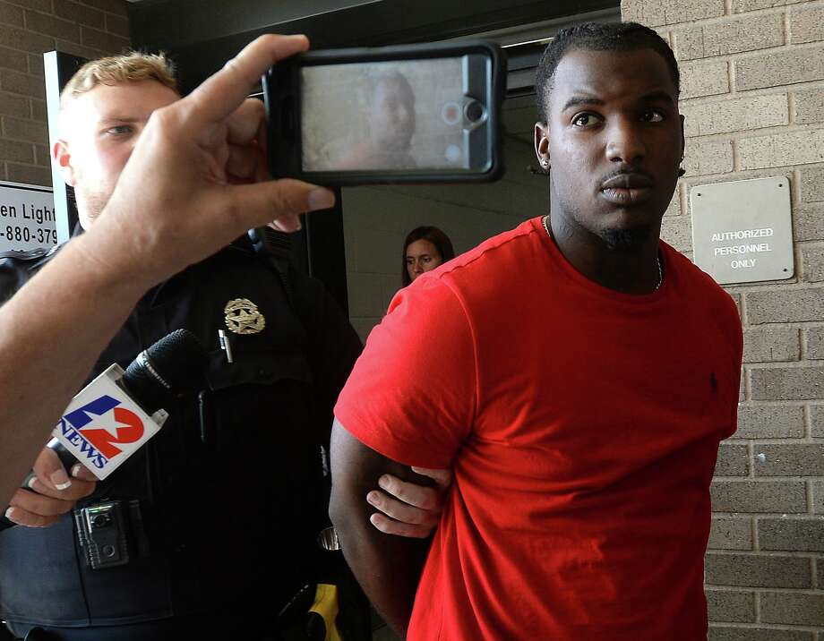 Martin Vincent Pettway, 21, of Port Arthur, is led away following his arrest in connection with the shooting death of Jesse Rodriguez Saturday on Eastex Freeway near Dowlen Road. Police say an interaction occurred inside the Cicis Pizza, after which Pettway and a group of other suspects followed Rodriguez outside and onto the freeway access road when the shooting occurred. 