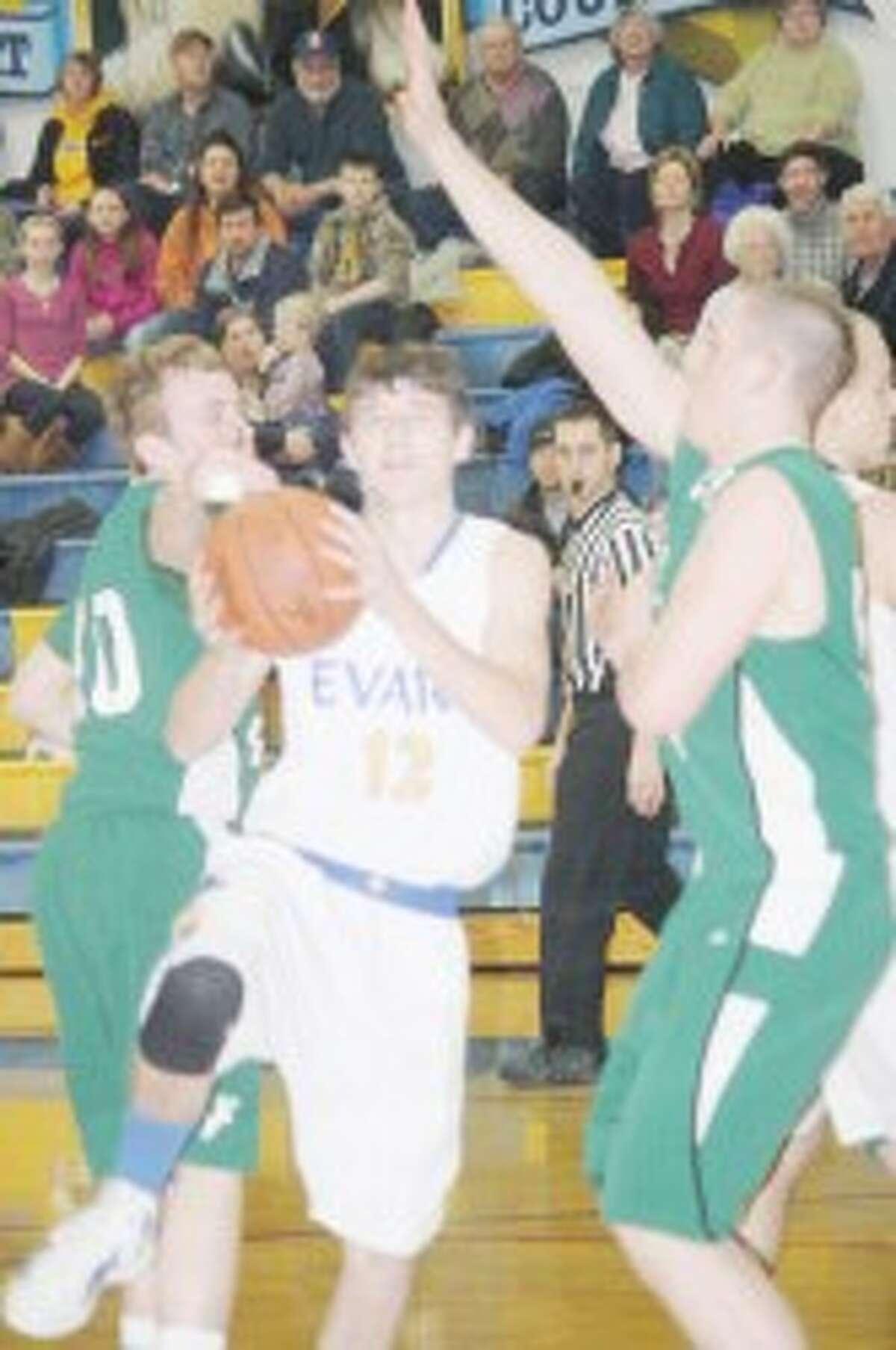 ACTION: Evart's Kameron VanScoyoc (12) goes to the basket against Pine River. (Herald Review/John Raffel)
