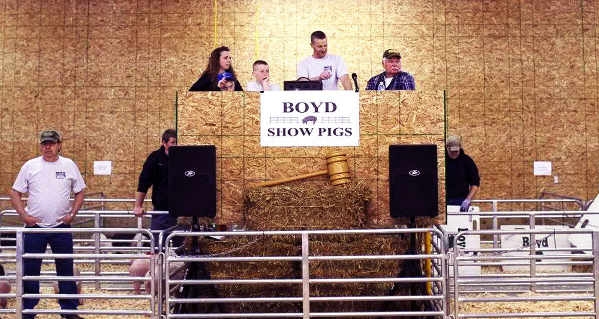 ANNUAL PIG SHOW: Nikki, Wyatt, Jacob and Scot Boyd host the annual Boyd Show Pig sale last year. This year, the show will be held on April 6 and around 200 pigs will be for sale. (Courtesy photo)