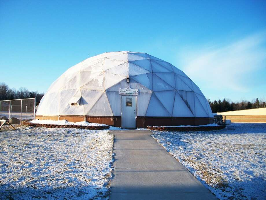GEODIESIC DOME: Jerry Hoppes teaches a variety of agricultural skills in this biodome classes. The highly efficient qualities of Reed City High School's Geodiesic dome make it the perfect tool for growing plants. (Courtesy photo)