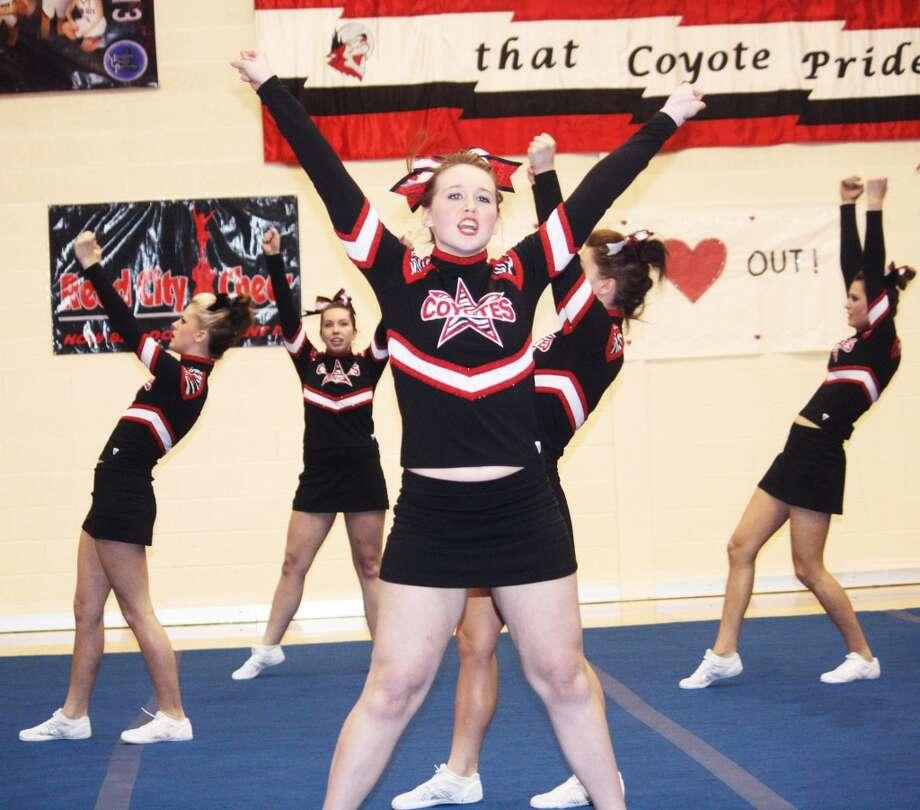 END OF SEASON: Reed City cheerleaders show their skills during the regular season.)