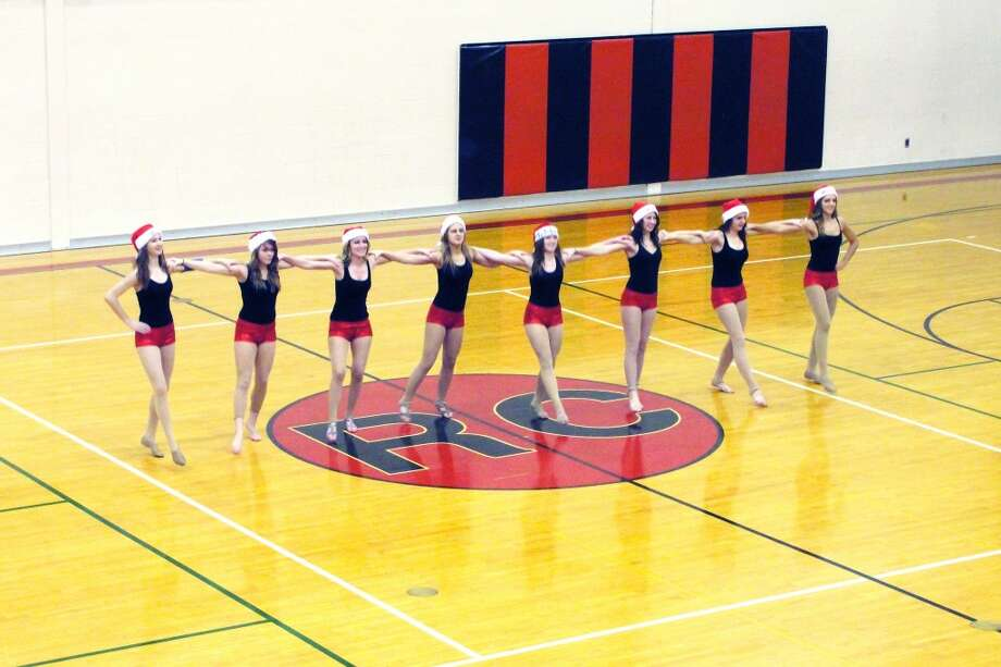 FOR THE HOLIDAYS: Santa hats and a festive kickline routine bought holiday spirit to the RCHS gym. (Courtesy photo)