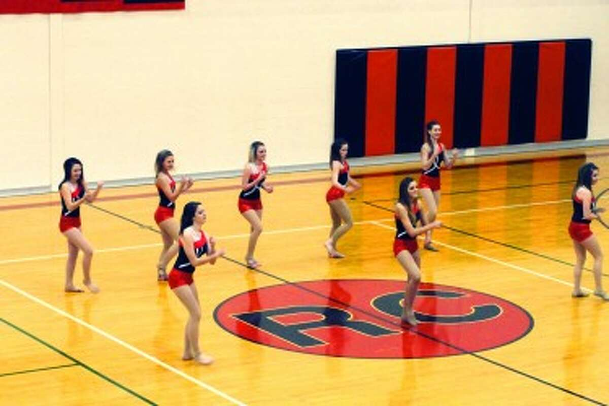 HALFTIME SHOW: RCHS Dance Team entertain the crowds during halftime at varsity basketball games.