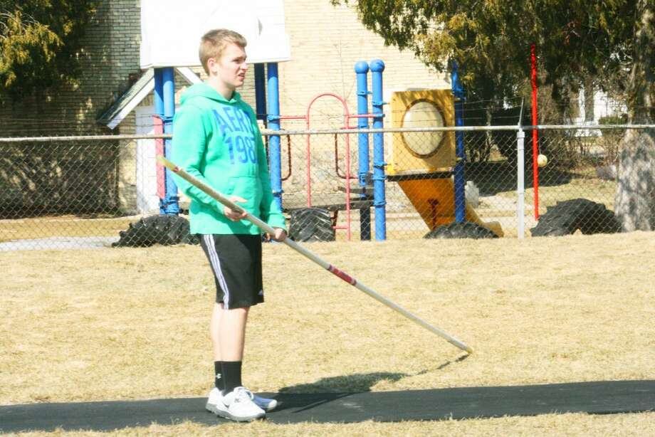 POLE VAULT: Dylan Langlois gets ready to practice the pole vault. (Herald Review/John Raffel)